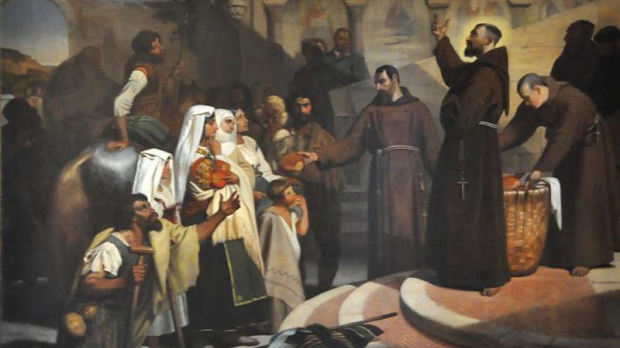 Saint François faisant l'aumône